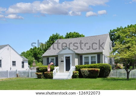 Suburban Cottage House Front Yard Lawn Landscaped - stock photo