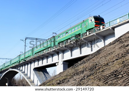 Suburban electric drive train on the brige - stock photo