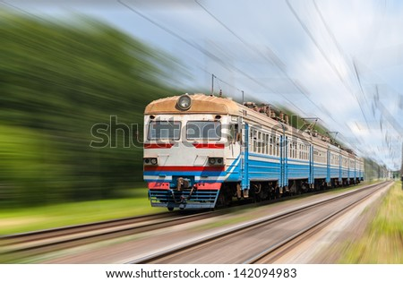 Suburban electric train on a blurred background - stock photo