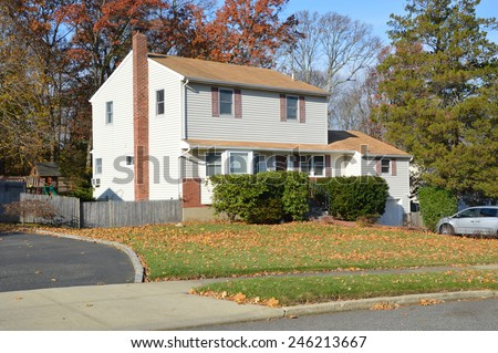 Suburban high ranch home autumn clear blue sky day residential neighborhood USA - stock photo