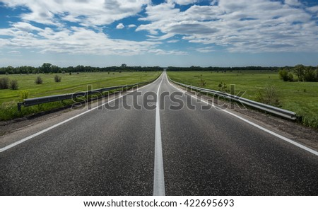 Suburban highway in the countryside - stock photo