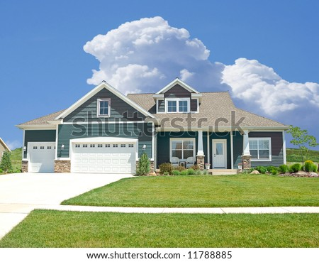 Suburban Home - A beautiful vinyl siding home in the suburbs in Michigan,  USA. - stock photo