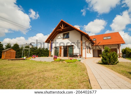 Suburban  Home and blue sky - stock photo