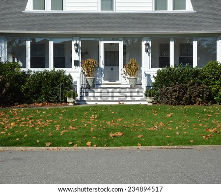 Suburban home entrance autumn leaves on front lawn residential neighborhood sunny USA day - stock photo
