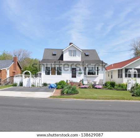 Suburban House Bungalow Home White Picket Fence Arch Gate - stock photo