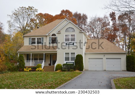 Suburban McMansion style home overcast sky day residential neighborhood USA - stock photo