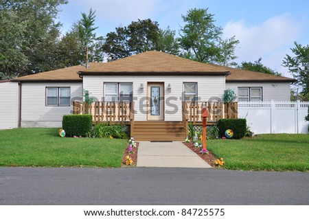 Suburban Middle Class Bungalow Home Walkway Front Yard Fence - stock photo
