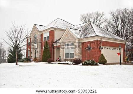 Suburban Neighborhood Brick Home in Winter - stock photo