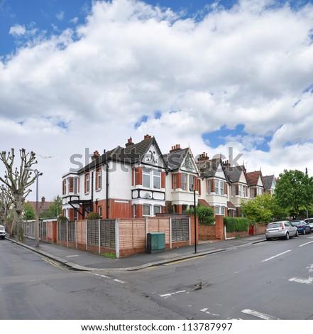 Suburban Neighborhood Victorian Terraced Row Homes on residential neighborhood street in London Europe - stock photo