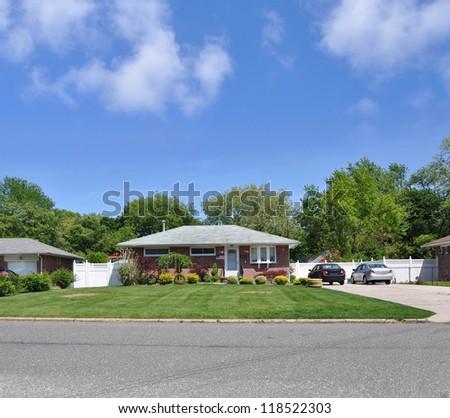 Suburban Ranch Style Brick home - stock photo