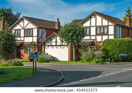 Suburban residential street with modern houses. West Midlands, England. - stock photo