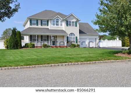 Suburban Two Story Double Garage Luxury Home Sunny Day residential neighborhood - stock photo