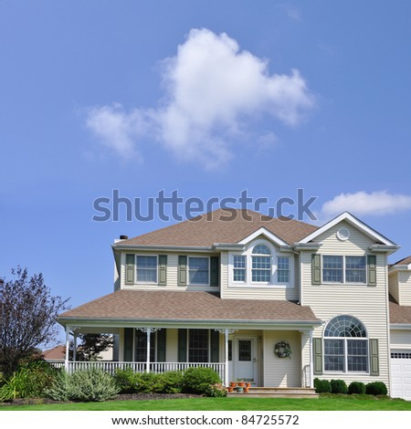 Suburban Two Story Home with Porch - stock photo