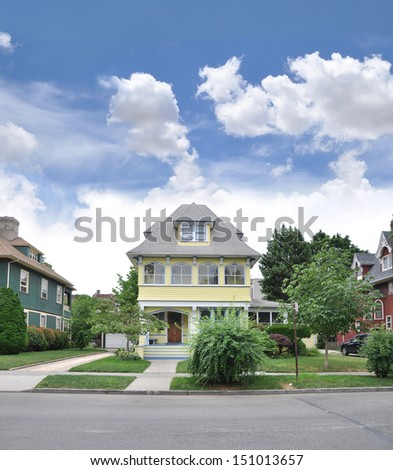 Suburban Victorian Style Home Front Yard Blue Sky Clouds - stock photo