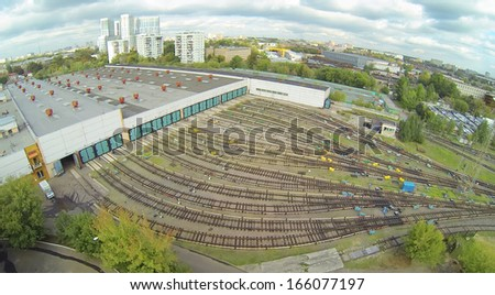 Subway depot with many railways at day in city. View from unmanned quadrocopter. - stock photo