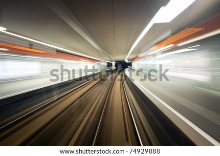 Subway train, driving at speed past a station - stock photo