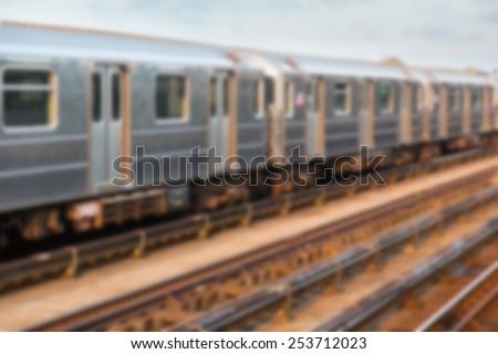 Subway Train in New York before Sunset. Blurred Background. - stock photo