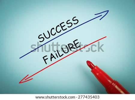 Success and failure concept is on blue paper with a red marker aside. - stock photo