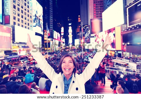 Success and fun- Happy excited woman in New York City, Manhattan, Times Square cheering celebrating joyful with arms raised. Cheerful Multiethnic Asian Caucasian young urban professional in her 20s. - stock photo