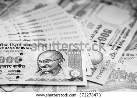 Success and got profit from business with 500 and 1000 banknotes of indian rupee currency,money with black and white color,Focus on eye of Gandhi - stock photo