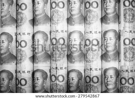 Success and got profit from business with roll China yuan currency ,money banknote on black and white color - stock photo