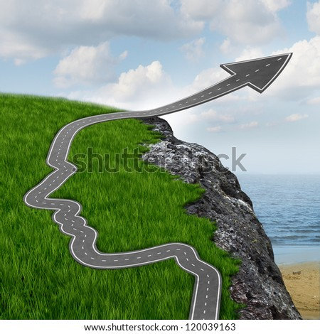 Success and risk and believing in yourself with education and planning setting your mind free with a highway in the shape of a human head going up as an arrow over a dangerous rock cliff. - stock photo