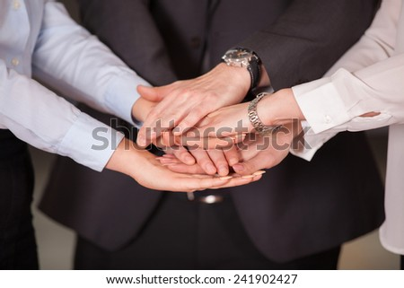 success and winning concept - happy business team in office - stock photo