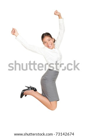 Success businesswoman jumping happy ecstatic celebrating with arms in the air. Fresh beautiful young casual mixed race Asian Caucasian business woman isolated on white background in full length. - stock photo