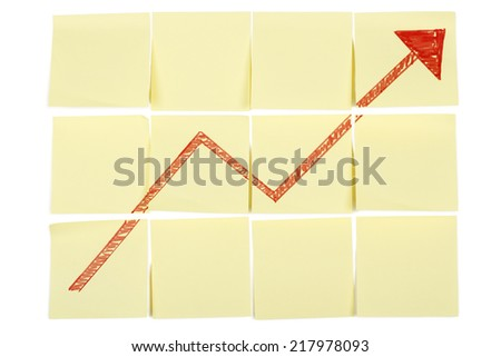 success concept with red arrow on post it notes - stock photo