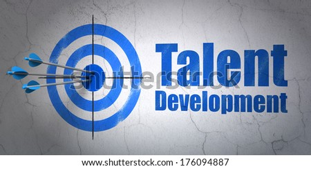 Success Education concept: arrows hitting the center of target, Blue Talent Development on wall background, 3d render - stock photo