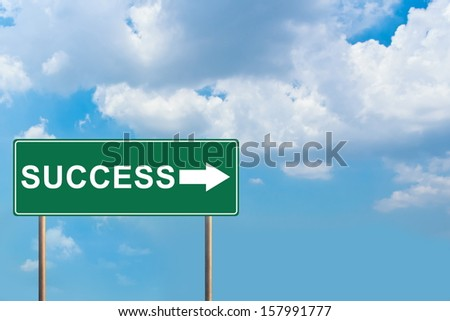 Success green road sign with blue sky - stock photo