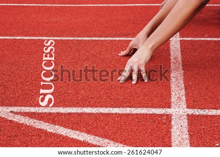 Success - hands on starting line - stock photo