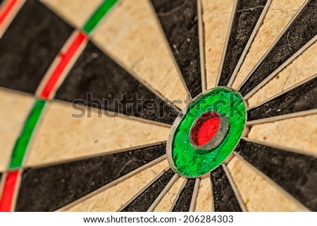 Success hitting target aim goal achievement concept background - bull's eye of darts board close up - stock photo