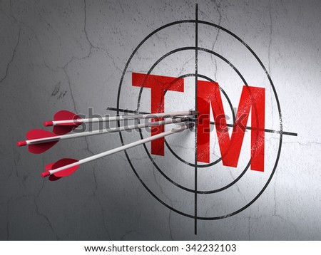 Success law concept: arrows hitting the center of Red Trademark target on wall background - stock photo