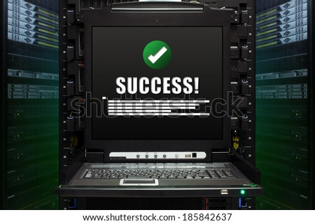 Success message show on the server computer display in the modern interior of data center. Super Computer, Server Room. - stock photo