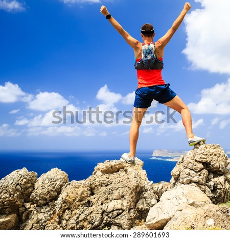 Success motivation happy man running or hiking, achievement successful and happiness concept, accomplished man celebrating with arms up raised outstretched climbing or trail running, healthy lifestyle - stock photo
