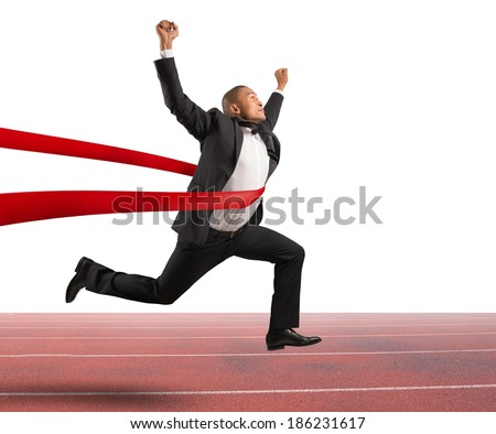 Success of a businessman in a finishing line - stock photo