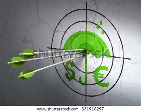 Success protection concept: arrows hitting the center of Green Money And Umbrella target on wall background - stock photo