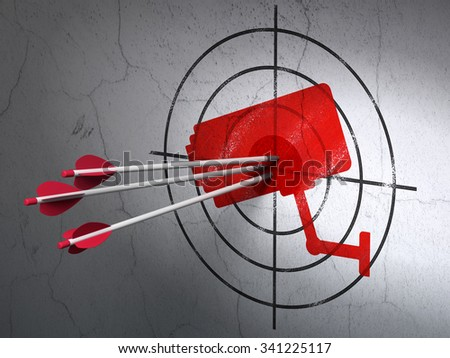 Success protection concept: arrows hitting the center of Red Cctv Camera target on wall background - stock photo