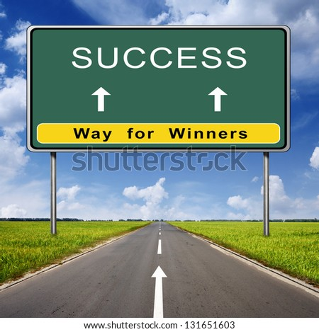success road sign on blue sky background and green field - stock photo