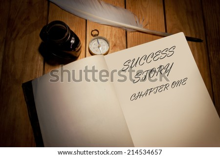 Success story first page of a book with quill and ink - stock photo
