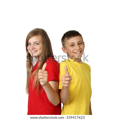 Success - teenage boy and girl in yellow and red t-shirts show thumbs up gesture with smiles isolated on white background in square - stock photo