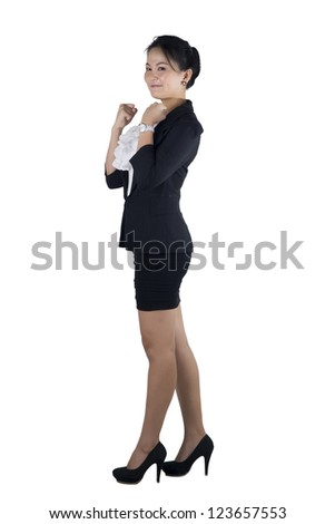 Success / winner business woman isolated white background. Celebrating happy young businesswoman in full length with her arms up. - stock photo