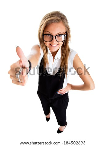 Success woman isolated giving thumbs up sign. Funny businesswoman in high and wide angle view. - stock photo