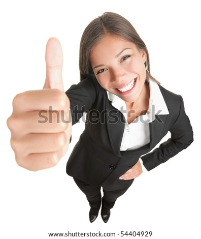 Success woman isolated giving thumbs up sign. Funny businesswoman in high and wide angle view. Mixed race Asian / Caucasian woman isolated on white background. - stock photo