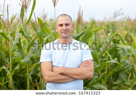 successful agriculturist in field of corn  - stock photo
