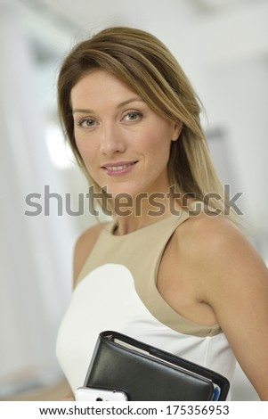 Successful and cheerful businesswoman - stock photo