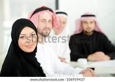 Successful and happy business arabic people sitting for a meeting - stock photo