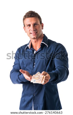 Successful and happy young man with euro bills or banknotes in his hands - stock photo