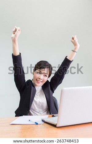 Successful asian business woman with arms up. - stock photo